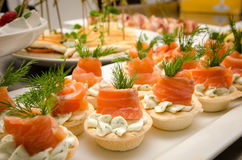 Tartlets with cheese filling and salted salmon Stock Images