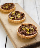 Tartlets with chocolate cream and lemon peel Stock Photo