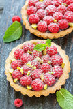 Tartlets with chocolate,fresh raspberries and pistachios. Royalty Free Stock Photography