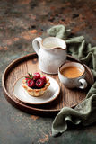 Tartlets with chocolate ganache and raspberries Stock Photography