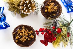 Tartlets with chocolate ganache. And roasting buckwheat groats Stock Images
