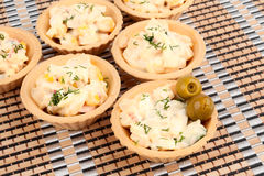 Tartlets with crab salad and olives Royalty Free Stock Photography