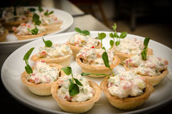 Tartlets with cream cheese salad. Close up view. Catering buffet table. Tartlets with cream cheese salad Stock Photography
