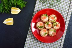 Tartlets with cream cheese and salted salmon on a red plate. Tasty light snack for a party. Finger Food. The top view stock photos