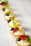 Tartlets with cream cheese and strawberries Stock Image
