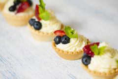 Tartlets with cream cheese and strawberries Stock Photos