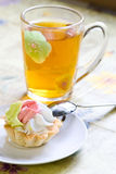 Tartlets with cream and cup of tea Stock Images