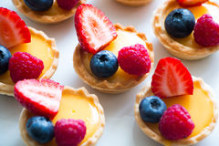 Tartlets with cream and fres berries Stock Photography
