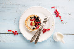 Tartlets with cream and fresh berries Royalty Free Stock Photography