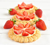 Tartlets with cream and strawberries Royalty Free Stock Photos