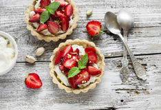Tartlets with cream and strawberries Royalty Free Stock Photography