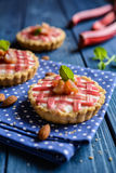 Tartlets with curd and rhubarb Royalty Free Stock Image
