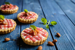 Tartlets with curd and rhubarb Royalty Free Stock Photos