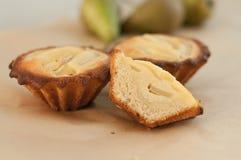 Tartlets de la pera y del frangipani Fotografía de archivo libre de regalías