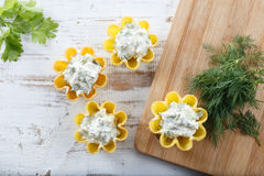 Tartlets filled with cheese and dill salad against rustic wooden background Stock Photos