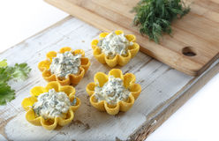 Tartlets filled with cheese and dill salad against rustic wooden background Royalty Free Stock Photos