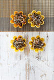 Tartlets filled with seaweed salad on bamboo placemat against rustic wooden background Stock Image