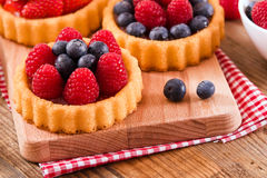 Tartlets with forest fruits. Stock Image