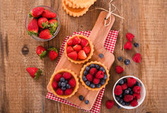 Tartlets with forest fruits. Royalty Free Stock Image