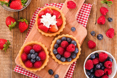 Tartlets with forest fruits. Stock Photo