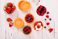 Tartlets with forest fruits. Royalty Free Stock Images
