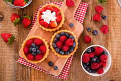 Tartlets with forest fruits. Stock Photos
