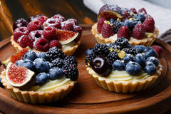 Tartlets with fresh berries Stock Photos