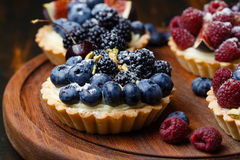 Tartlets with fresh berries Stock Photography