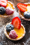 Tartlets of fresh berries and icing sugar Stock Photo