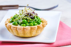 Tartlets with green peas Royalty Free Stock Images