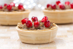 Tartlets with liver pate and pomegranate seeds for Christmas Royalty Free Stock Photography