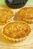 Tartlets with nuts. Tartlets with mashed nuts and honey Royalty Free Stock Images