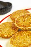 Tartlets with nuts. Tartlets with mashed nuts and honey Royalty Free Stock Photo