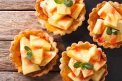 Tartlets with pineapple, jam and mint close-up. Horizontal top v Stock Photography