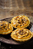 Tartlets with pumpkin cream for Halloween for kids Royalty Free Stock Photography