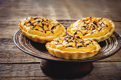 Tartlets with pumpkin cream for Halloween for kids Royalty Free Stock Images