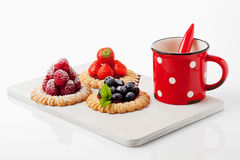 Tartlets, raspberry, strawberry and blueberries, coffee. Cup on white background Stock Images
