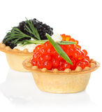 Tartlets with red and black caviar isolated on white Royalty Free Stock Photos