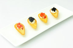 Tartlets with Red and Black Caviar Stock Photography