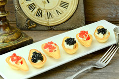 Tartlets with Red and Black Caviar Stock Photos