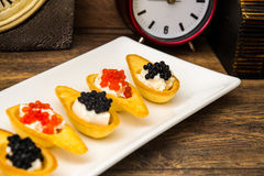 Tartlets with Red and Black Caviar Royalty Free Stock Image