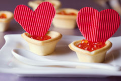 Tartlets with red caviar Stock Images