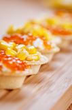 Tartlets with red caviar and corn Royalty Free Stock Photos