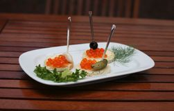 Tartlets with red caviar and cucumber on the plate Royalty Free Stock Photo