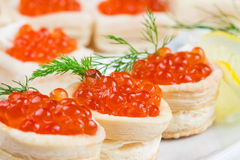 Tartlets with red caviar Stock Photography