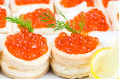 Tartlets with red caviar and  lemon Royalty Free Stock Photography