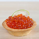 Tartlets with red caviar and lime Stock Photography
