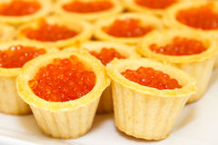 Tartlets with red caviar. The luxurious table. Stock Photo