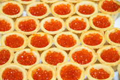 Tartlets with red caviar. The table decorations. Royalty Free Stock Image