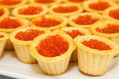 Tartlets with red caviar. Stock Images